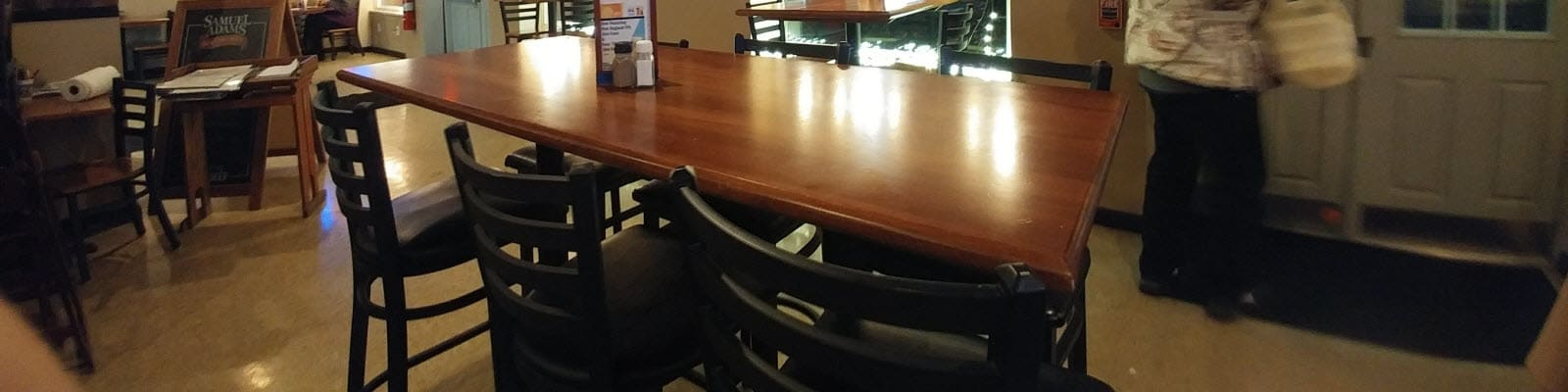 Metal restaurant bar stools and wood table top